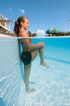 Hip and Lower Back Stretch - Stand on your left leg in chest-deep water. Grab your right knee with both arms and pull it to your chest, standing tall and keeping the natural curve in your spine.