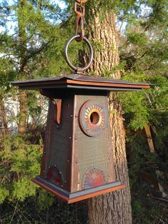 Prairie Fire: An Arts and Crafts style birdhouse handmade at Roundhouse Works from recycled wood (pine barn siding and walnut veneer scraps) and metal, including tin, steel, copper (given a rainbow torch finish) and iron.