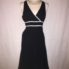 Cute Dress This is a little black dress with white piping accents. It's fitted through the waist with a razor back. Great for special occasions. It has a flare flirty fit at the bottom.this dress has a side zipper. Evan Picone Dresses