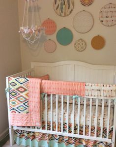 Aztec and arrows baby girl bedding in peach mint cream and gold