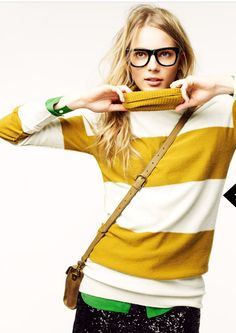 Yellow and white sweater, though what I love most is the little bit of green shirt fringed at the bottom and the cuffs.