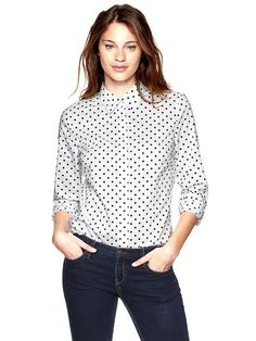Just bought this shirt, in both the navy dot and the fuchsia dot. Love it!