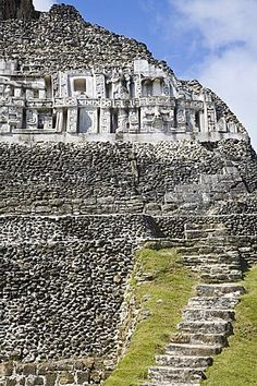 Frieze and steps up to the 130ft high El Castillo, Mayan site, Xunantunich, San Ignacio, Belize, Central America
