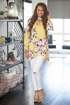 You are definitely going to want this classic tunic in your life! Featuring the sweetest floral print in bright yellow, navy, light pink, purple, white, and blush pink, it's such a must-have look for