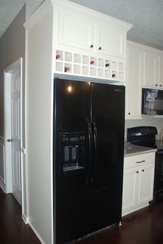 Kind of like this above fridge, not built in but with one cabinet to the left--like vetter's kitchen