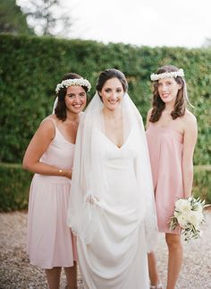 Bride with Bridesmaids in Pink Dresses and White Flower Crowns | Brides.com