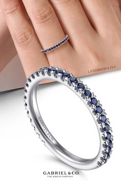 A timeless stackable ring with a sleek straight silhouette and dozens of glamorous sapphires. Crafted from luxe 14K white gold, this September birthstone ring effuses any ensemble with a pop of vibrant blue color. LR50889W4JSA#GabrielNY#UniqueJewelry#FineJewelry#GabrielAndCo#FashionJewelry#UniqueJewelry#GiftIdeas#DiamondJewelry#Jewelry#gabrieljewelry#UniqueGifts#Jewelry#Design#HandcraftedJewelry#Elegance#Rings#FashionRing#UniqueRings#Stackable#DiamondStackable#StackableRing#SapphireStackableRing Gabriel Jewelry, September Birthstone Rings, Stackable Rings, Birthstones, Sapphire, Jewelry Design, White Gold, Vibrant, Silhouette