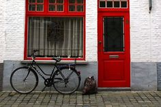 Bruges Photos at Frommer's - A bicycle leaning against a house in Bruges, Belgium. Photo by dracisk/Frommers.com Community