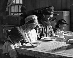 amish family praying before a meal