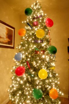 "CELEBRATE the NEW YEAR: Turn a Christmas Tree into a New Year's Tree - remove ornaments and replace with balloons with money and  ""fortunes"" or New Years wishes inside. Tie to tree along with inexpensive New Year's noise makers & such. Celebrate by popping balloons at midnight."