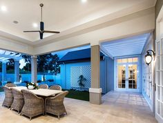 Hamptons style alfresco area with cane tub chairs - Oswald Homes