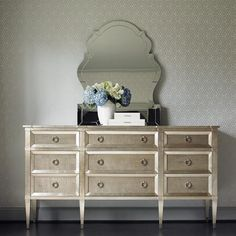 #Caracole: Italian Dressing.  Pure classic design appeals to most designers in that it flows effortlessly amongst a variety of styles, making it a timeless, go-to piece. Highly figured tiger maple veneers are washed in a soft Smoke grey finish that is framed by a Taupe Silver Leaf application to add highlights.