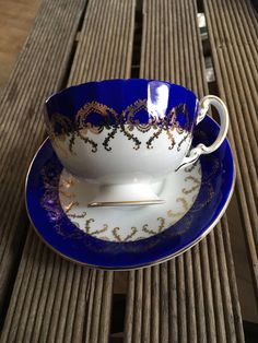 Ainsley, ultramarine blue ornate gold plated tea cup and saucer with flowers in cup and butterfly on saucer. fine english bone china This set is in exceptionally beautiful condition without flakes and cracks and without gold plated loss. It was my painting inspiration. Do you have a