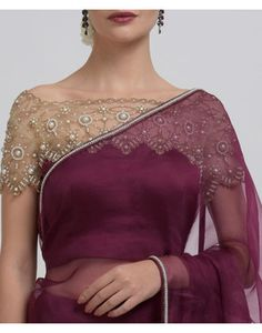 This is a burgundy pure organza silk saree adorned with hand embroidered Pearl beads embellished borders all around. The saree is finely finished with satin trimmings. The saree is paired with a stunning blouse handcrafted in pure satin crepe blo Saree Jacket Designs, Saree Blouse Neck Designs, Silk Saree Blouse Designs, Saree Blouse Patterns, Designer Blouse Patterns, Fancy Blouse Designs, Bridal Blouse Designs, Net Saree Blouse, Lace Saree