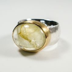 Aquamarine ring set in 22k gold and silver. Www.hoogenboombogers.com