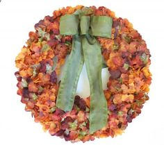 Autumn Fall Wreath - Hydrangea Door Wreath with bow WR4519. This foam based hydrangea cluster wreath in autumn colors with a green wired ribbon.  This wreath is lightweight and will fit great on a storm covered door. #fallwreaths