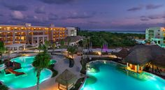 A picture perfect view of the grounds of Paradisus Playa del Carmen La Esmeralda at sunset