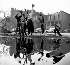 Gordon Parks, Ghetto Neighborhood, Chicago, IL, 1953 - I really like the reflection in this photo. It shows dimension and the monochromatic colors really enhance the features in the reflection
