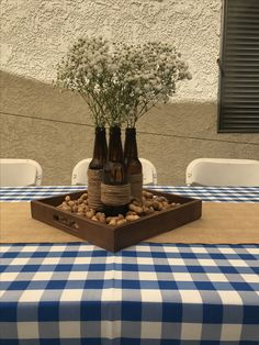 Beer bottle centerpieces. Cheers and beers to 30 years. Bbq theme party.