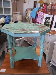 Turquoise hexagon distressed table.