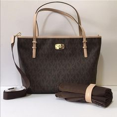 Michael Kors Diaper Bag NWT Brand new with tags Michael Kors Diaper Bag from the Jet Set Collection. Includes diaper changing pad and detachable strap to turn bag into crossbody hands free. Sold out in stores. MICHAEL Michael Kors Bags Baby Bags