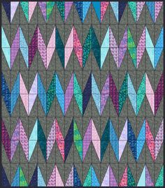 """A new form of Chevron using half rectangles from layer cakes. Finished size is 63"""" x 72"""""""