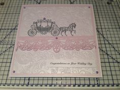 Wedding card made using Embossalicious embossing folder, Sue Wilson border die & Tattered Lace carriage die.