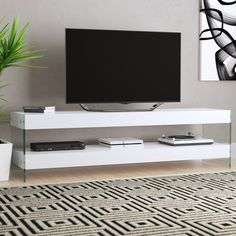 Shop a great selection of Matewan TV Stand TVs 78 Wade Logan. Find new offer and Similar products for Matewan TV Stand TVs 78 Wade Logan. Tv Stand And Panel, Tv Stand Set, Living Room Furniture, Home Furniture, Living Room Decor, Adjustable Shelving, Open Shelving, Tv Stand Decor, Floating Tv Stand