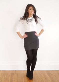White blouse, gray pencil skirt, black tights and black heels.