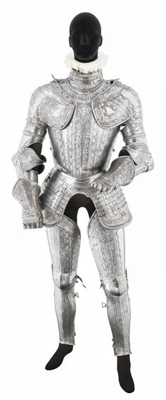 **A COMPOSITE NORTH ITALIAN FIELD ARMOUR WITH LATER ETCHED DECORATION, MID- TO LATE 16TH CENTURY
