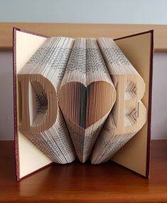 The 50 Best Wedding Gifts You Can Get On Etsy | Emmaline Bride Folded Book Art, Book Folding, Laura Slater, Christmas Time, Christmas Gifts, Book Pages, Graduation Gifts, Wedding Gifts, Wedding Season