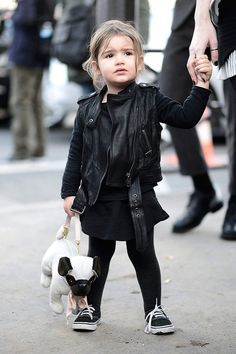 I don't think anyone is more fashionable than this little girl in her black Vans carrying a pug bag.