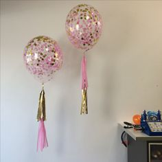"""Medium 16"""" Diamond Clear treated with hi-float and confetti (pink and gold) with a mini tassel in complementary colours. A sweet table or floor centrepiece"""