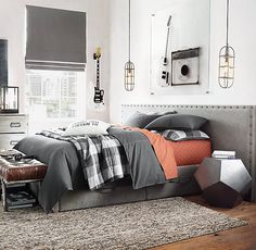 Gray and orange bedroom is perfect color scheme for a teen boy's bedroom.