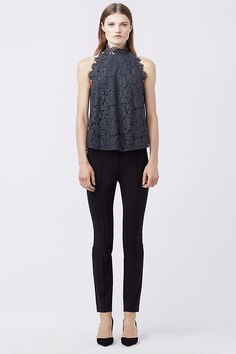 The DVF Jemmie features a high neck, lace overlay, and an open back. Pair with a clean white short and a wedge sandal.