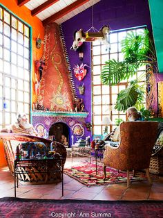 San Miguel de Allende, Guanajuato, Mexico:  Anado McLauchlin, right, and his husband Richard Schultz in the living room of their the eclectic home. On their coffee table sit the wedding cake dolls used at their wedding. The interior of the house is covered in tile mosaic collages and decorated with McLauchlin's altars. Every wall and even ceilings are different colors. It is on an acre of land outside San Miguel Allende, Mexico. June 2009. (photo: Ann Summa)..