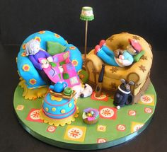 Mum and son's shared birthday - I made this cake not long after having started cake decorating and it's still one of my favorites. Pound cake decorated with fondant. I love all the colors and I always wonder what the two of them are talking about when I look at the pictures :)