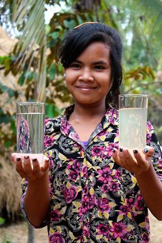 A young woman in Cambodia showed our team the difference between groundwater she used before… and the clean water she uses now from her BioSand filter. (Photo: Jonna Davis)