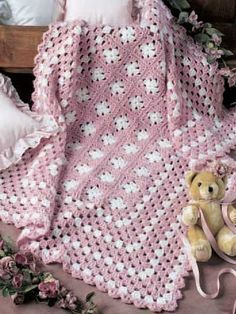 I have made this twice: one in pink and one in blue. You never know what kind of baby is on the way. Beautiful!! Easy. Fast. You will like this pattern. The granny squares were two rounds. I made them three rounds. Wanted a wee bit bigger.