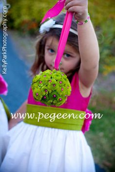 Flower girl dresses in hot pink, green and white.  From the Pegeen Classic Collection, style 383 in  silk with hand made silk flowers. Available in infant through plus size in 200+ colors of silk.