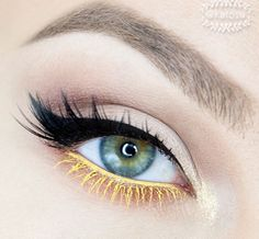 Simple eye makeup with cool yellow eyeliner and mascara