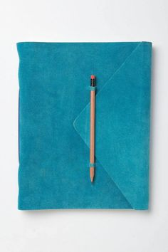 Jot down all your thoughts in this suede journal.