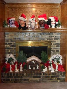 WOW! best mantle I've ever seen.  Horror Christmas. Monster. Jigsaw. Vampire. Wolf. Jason Voorhees.