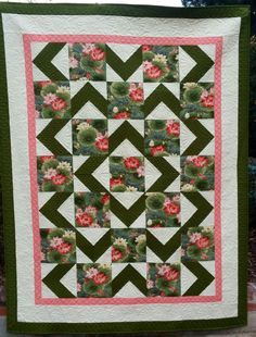 Walk About quilt. I like this but instead more black and an outline in floral and the inside floral with the chevron.