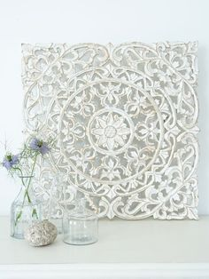These intricately carved white wall panels can be used in several ways...