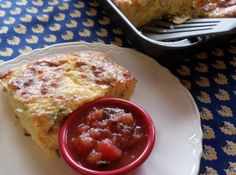 Oven Omelet  18   eggs, beaten lightly     2 lb   (or less) grated cheddar cheese     2 lb   cottage cheese     2 c   milk     2 c   bisquick     1 c   (2 sticks) butter, melted   get recipes @ goboldwithbutter.com        2 c   green onions, sliced     1 lb   bacon, cooked crisp and crumbled
