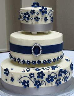 White and navy cake with some very cute elements (e.g. Blue flowers)