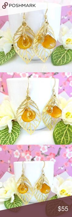 Gold leaf citrine and yellow chalcedony earrings This is a gorgeous pair of gold leaf citrine and yellow chalcedony earrings. The leafs are cut delicately and are gold plated. One high quality AAA micro-faceted sparkly citrine tear drop briolette and one AAA micro-faceted yellow chalcedony heart briolette hangs from the top of each leaf. They come with high quality tarnish resistant gold-filled coil earring hooks. Leaf 19x35mm. Comes gift wrapped Kblossoms Jewelry Earrings