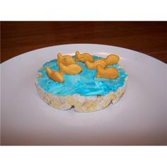 Rice cake + blue cream cheese + gold fish crackers = An easy snack for kids in summer