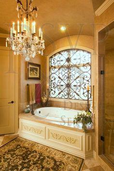 Great bathroom, love the iron piece in window..
